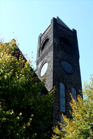 The Pilgrim Congregational United Church of Christ has turrets and a 150 foot tower.  It was built in 1894 for a congregation which began in 1859, comprised of 34 members of different Christian backgr