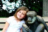 We have a picture of Mac with this monkey from her very first visit to the Zoo when she was a baby and have to stop and take another one every time we come by it.  (July 3, 2007)© Carolyn S. Murray 20