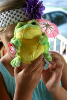 Ashley and Ava came over to show me this frog -- all ready for Ava's  birthday luau!  (September 5, 2009)© Carolyn S. Murray 2009