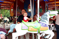 Dad and Isaac riding the merry-go-round.  (September 27, 2008)© Carolyn S. Murray 2008