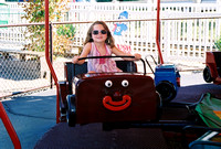 MacCaila behind the wheel of one of the cars at the Kiddie Park.  (August 16, 2006)© Carolyn S. Murray 2006
