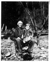 This is one of our favorite family photos:  Amma sitting on the lap of her Grandpa Maddron (Benjamin Richard Maddron.)
