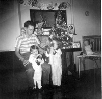 Debby and I with our Dad on Christmas morning, 1959.