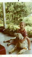 "Kevin on Mamaw and Papaw Maddron's front porch, ""riding"" one of their dogs!"