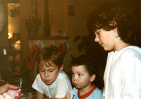 The looks on our kid's faces was great to see -- as they watch Cousin Don perform one of his world-famous card tricks!  (December 1984)