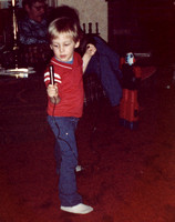Craigums rockin' out on his fourth birthday!  Uh, Craigie .... the microphone needs to be plugged in to something ....  :-)(March 1983)