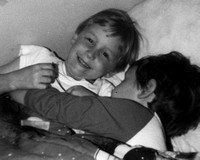 I'm sure this was staged and Chas was not really hugging his brother .... which Craig found very amusing.  (December 1983)