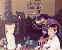 Christmas morning and Dad was already putting toys together.  (December 1983)