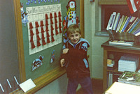 Craig doing his Vanna White impersonation at his school open house.  (November 1985)